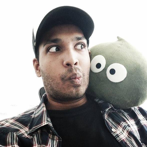 Nicholas with Peatix's mascot, Pea-chan